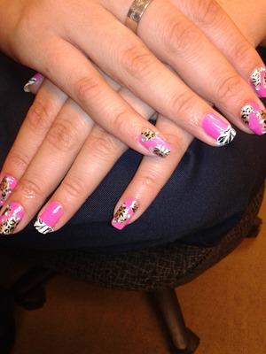 Pink/cheetah/zebra nails with rhinestones.