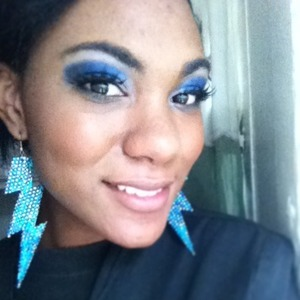 I did this while I was still in school. I had bought some ELF eyelashes and wanted to try them out. As it turned out I really love lashes. I had never tried them until that day I bought them. I love the color blue.( And since our uniforms are all black with a hint of blue in the picture on your smock.) I felt like maybe I should coordinate a little bit. :)