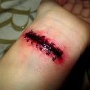 Stiched Slit Wrist Make-Up Fx
