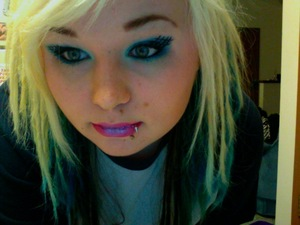 Crosshatched eyes. Again! Light blue lip highlight. Simulated dreads hairstyle.