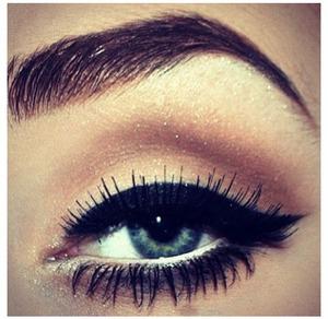 Bronzy gold natural eye makeup .