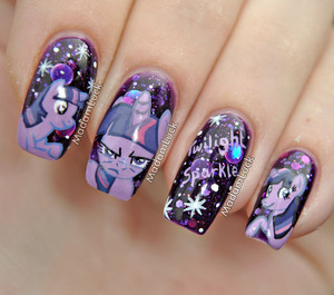 my daughter is crazy about MLP and twilight sparkle is her favorite...she asked me to paint her on my nails when she saw my emily de molly polish called cosmic forces so of course i painted her favorite pony