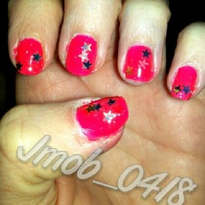 Awesome bright pink polish with star glitter.