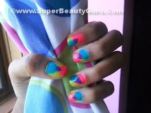 Like this nail look? check out my tutorial on my blog: http://superbeautyguru.com/overlapping-triangle-nail-tutorial/