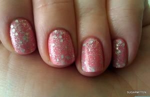 http://sugarmitten.wordpress.com/2012/02/01/revlon-starry-pink-over-revlon-candy/