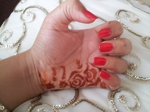 Tried a new style of henna (mehandi) Red nails forever <3