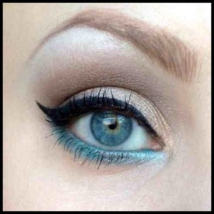 This was created using Urban Decay's Naked 2 Palette and a glittery cyan shade from a cheap palette I got as a gift a few years ago.