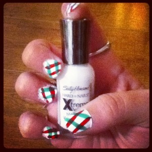 Some simple Christmas nails. Takes about 5-15 minutes depending on how long ur colors take to dry. Steps: 2 coats white base. when dry, do two angled lines of red/green. when that color dries, take the other color and do two more stripes on top of the first two.