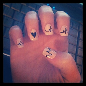 pink nails with black hearts