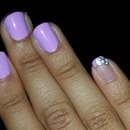 Lilac nails with Hello Kitty bow