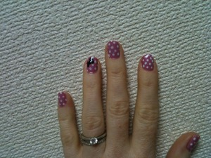 Minnie Mouse inspired nails. I used pink rather than red after my baby girl got a Minnie mask with a pink bow (it was really cute).