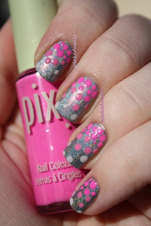 Gradient dots over holographic polish, done using dotting tools of various sizes and multiple colors of pink polish