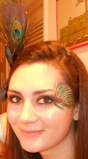 My sister Julia as a peacock...I only had 5 minutes to make the peacock feather on her face...but I will have more time next weekend to make it look better :) 10/22