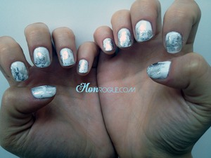 Silver foil nails on white polish. Love love love this look.. probably one of my favorites I've done!! http://monrogue.com/silver-nail-foil-design-on-white-nail-polish/