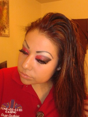 Getting ready for work. Had to match my shirt..with red/black eyeshadow