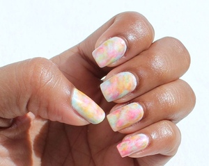 Using two summer neon colours from China glaze, a white base, blue polish, top coats and acetone to create this beautiful design. For more information and a tutorial see :http://chinadolltt.blogspot.com/2012/06/watercolour-nails-tutorial.html