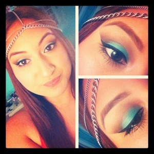 Laura Mercier creme shadow in aqua mixed with turquoise caviar stick and cafe au lait in the crease.