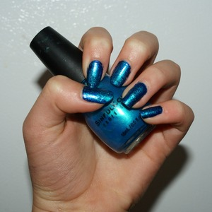 I used a Navy blue Base coat, then put light blue nail polish on a make up sponge, then dabbed it on top!
