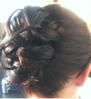 Side view of a detailed bun updo