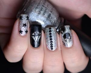 Blingy skittle nail art http://www.xoxoalexisleigh.com/2012/11/diamonds-skulls-unicorn-lets-not-forget.html