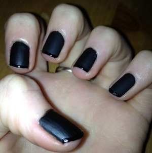 Paint the whole nail matte black, leave it to dry then paint a tip on like a French Manicure with a shinny black. :)