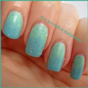 """this is a """"mood potion"""" which changes from blue to green with your body heat.  This is mid-change.  The green is hot and the blue is cold.  There is fine teal holo glitter throughout the polish"""