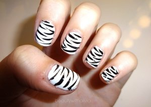 I can't wait for my nails to grow longer so I can do better designs. But I think these turned out cute! :)
