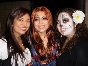 Some halloween makeup I did. Well mine (far right) and Chucky's (middle of course). :)