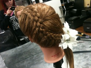 Practicing five stand braids on my mannequin head in cosmetology. I think this would be great for a formal event.
