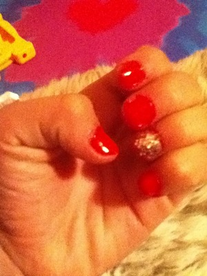 Red nails and one with silver glitter