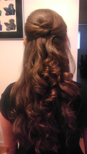 Curls, half up half down, a little tiny backcomb, held together with a few pins