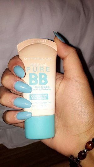 Stunning blue coffin nails, alongside Maybelline BB cream,