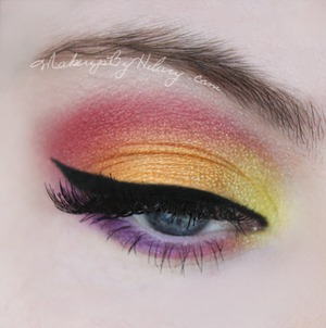 """My go-to dramatic look is definitely colourful and attending demanding. I love doing """"sunset"""" eyes because they are perfect for summer!  I would really love it if you'd vote for my contest entry here: http://bit.ly/MXIJUP"""