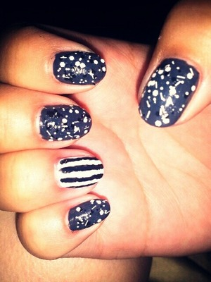 charcoal gray nails with black and white glitter and striped accent nail! :)
