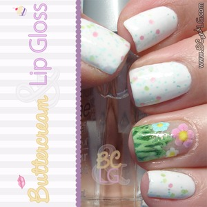 Perfect for spring.  Used a white base and pastel glitter polish and painted grass and pastel flowers on the ring finger.  Details and be found on the blog: http://www.buttercreamandlipgloss.com/2014/03/notw-spring-flowers.html