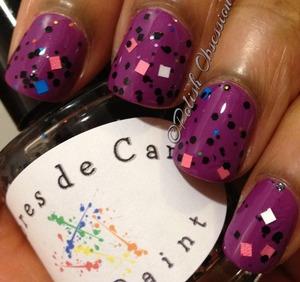 Blue, pink, and white square glitter.  Black hex glitter