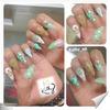 stiletto white and green nails