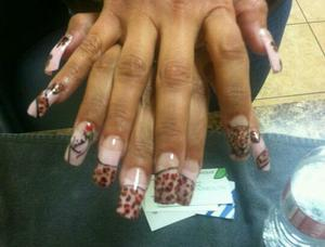 Leopard print inspired nail art. everything is freehand. my client asked me to autograph one of her nails.