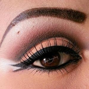 Cat eyeliner Dark shadow Peach to shades  And black under liner.