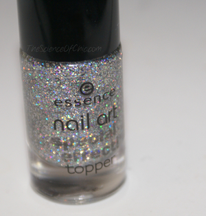 Essence Nail Art Special Effects Topper in Hello Holo This is such a fun top coat! The holographic glitter is a little spaced out, but the overall effect is stunning especially when several coats are applied.