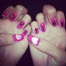 Love Pink nails with heart and diamond