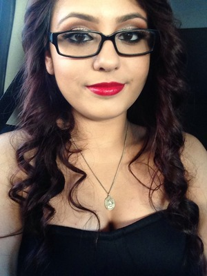 I did a warm eye look with red lips. I was the maid of honor in my parents wedding :)