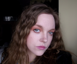 I've seen pastel orange eyes and pink lips in so many magazine's as a spring 2012 trend, so this is me trying it out with 80s crimped hair!