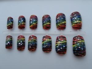 Buy them here: http://www.etsy.com/listing/107691474/rainbow-zebra-nail-set