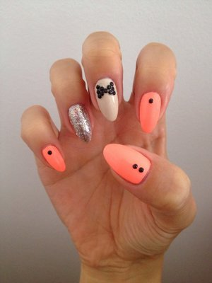 Natural Stiletto nails with a bright fun peachy coral polish and detailing