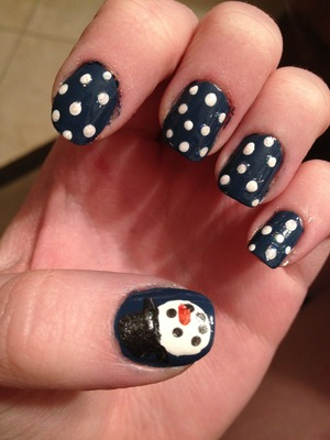 Holiday Spirit! Snow flakes and a snow man on the thumb. This actually isnt the final product. I went back and added a dot of wet n' wild glitter on each snow flake so they would sparkle <3 Let it snow!