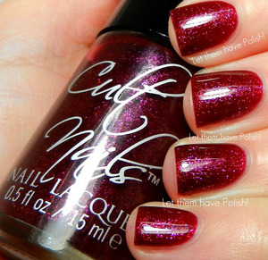 A beautiful Raspberry jelly/shimmer with flashes of Pink and Violet shimmer.  Behind Closed Doors Collection