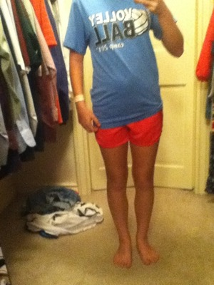 My blue volleyball shirt and my pink shorts.