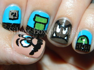 Nail art inspired by The Super Mario Brothers video game. Featured designs; Mario and a Goomba.
