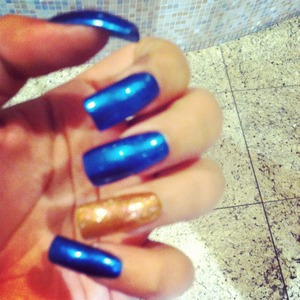 The gold enhances the dark navy blue color